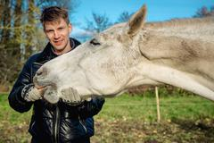 man and horse outdoors - stock photo