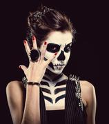 Woman with skeleton face art over black background Stock Photos
