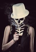 woman with skeleton face art smoking - stock photo