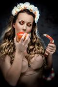 Sexy beautiful woman with red apple and snake, conceptual photo Stock Photos