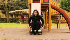 35 years woman playing in playground area Stock Footage