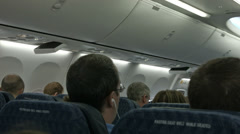 Airline passengers prepare for takeoff HD BM 1321 Stock Footage