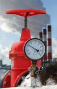 manometer, red valve on hot pipe - stock photo