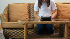 Asian girl playing tablet Stock Footage