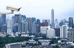 Stock Photo of security camera monitoring the traffic movement on top view of cityscape.