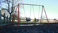 Stock Video Footage of Empty swing in desserted playground (dolly)
