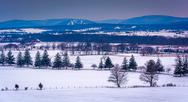 Stock Photo of view of snow-covered farm fields and distant mountains from longstreet tower,