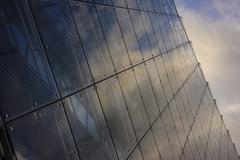 Close up of clouds reflected in windows of highrise Stock Photos