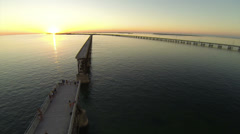 Flying over the Bahia Honda State Park Bridge at Sunset in the Keys Stock Footage