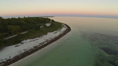 Flying over a white sandy beach during sunset in the Florida Keys Stock Footage