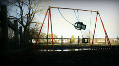 Empty swing in deserted playground - sinister (dolly zoom) Stock Footage