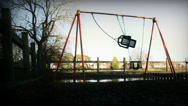 Stock Video Footage of Empty swing in deserted playground - sinister (dolly zoom)