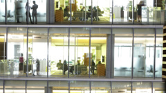 Time lapse of busy city office workers together in large modern office building Stock Footage