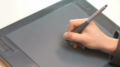 Hand drawing on tablet Stock Footage
