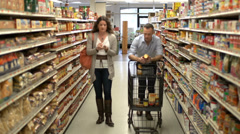 Married couple shopping for groceries (9 of 9) - stock footage