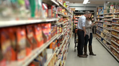 Husband and wife in a grocery store (1 of 9) - stock footage