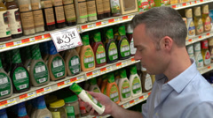 Examining food labels (1 of 9) - stock footage