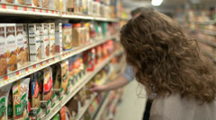 Examining food labels (4 of 9) Stock Footage
