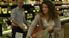 Married couple shopping for groceries (8 of 9) Stock Footage