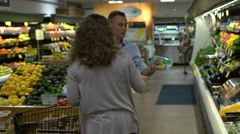 Husband and wife in a grocery store (4 of 9) - stock footage