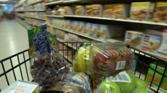 Pushing a shopping cart in a grocery store (3 of 4) - stock footage