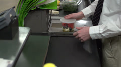 Check-out at a grocery store (4 of 9) - stock footage
