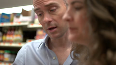 Husband and wife in a grocery store (9 of 9) - stock footage