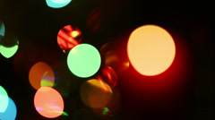 Burning candle on background of holiday lights - changing focus Stock Footage