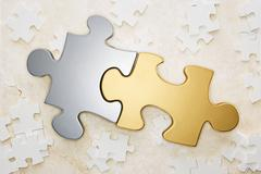 Close up of gold and silver puzzle pieces Stock Illustration