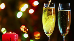 glasses with champagne and candle - romantic evening - stock footage