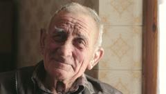 Close up of a smiling old man looking at the camera - farmer Stock Footage