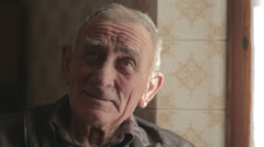 portrait of a smiling old man looking at the camera - stock footage