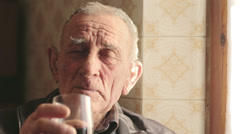Old man tasting a red wine Stock Footage