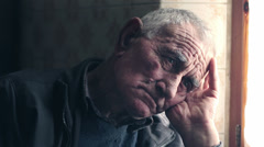 Portrait of an expressive sad old man Stock Footage