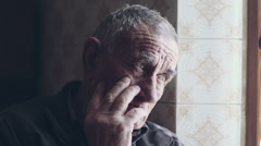 Old senior man closeup serious expression portrait - stock footage