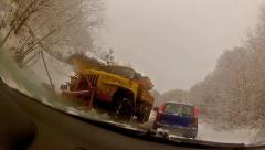 Snow blower removing snow from mountain road. large vehicle pushes ice and sn Stock Footage