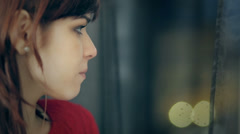 Sad girl near window thinking about something Stock Footage