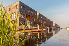 Row of dutch modern canal houses in almere Stock Photos