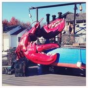 Large lobster decoration on dock Stock Photos