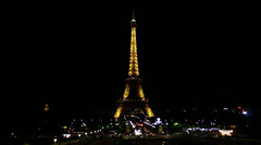 Paris: Eiffel Tower by night Stock Footage