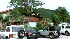 British Virgin Islands Tortola Road Town 014 cars parking at a restaurant - stock footage