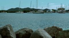 British Virgin Islands Tortola Road Town 047 rocks at the shore Stock Footage