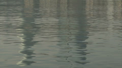View at the sea in Baku with reflection on Baku Flame Towers Stock Footage