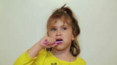 Pretty little girl brushing her teeth Stock Footage