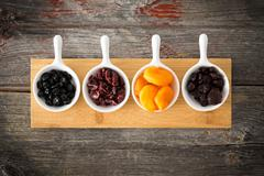 Dried cranberry, apricot, blueberries and cherries Stock Photos