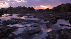 Rocky Alien Landscape with Rock Pools Reflecting a Beautiful Sunrise Stock Footage