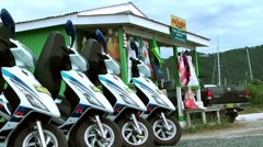 British Virgin Islands Tortola Road Town 012 a row of motor scooters Stock Footage