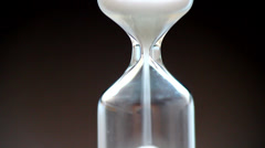 Hourglass pouring out sand Stock Footage