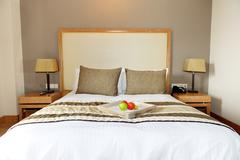 apartment in the luxury hotel with apples on bed, halkidiki, greece - stock photo
