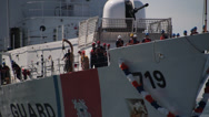 Stock Video Footage of USCGC Boutwell Being towed or tugged into port 3